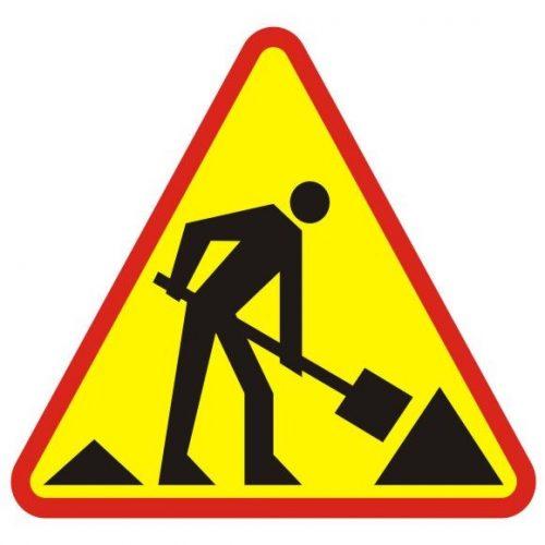 znak - roboty drogowe - na trójkątnym znaku widać obrys mężczyzny z łopatą w rękach, przekopującego ziemię